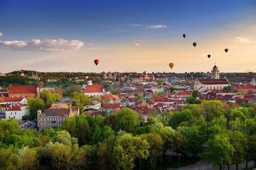 Beautiful panorama of Vilnius old town with hot air balloons in the sky