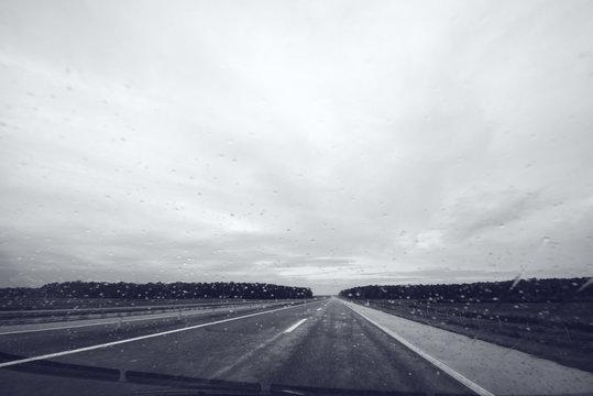 Raindrops on car windshield glass