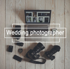 Wedding photographer work tools flat lay. Top view on photo cameras with equipment, smartphone, bundle of money and laptop with wedding photos on light wooden background.