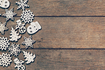 Wood christmas decoration on wood background with copyspace.