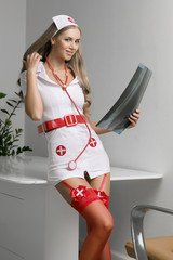 Sexy beautiful female blonde doctor with x-ray.