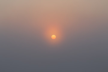 Sun in the mist at dawn