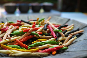 Traditional colorful Italian dried homemade pasta fusilli with eight colors