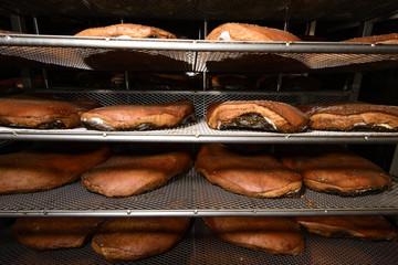 smoked ham in industrial seasoning cell