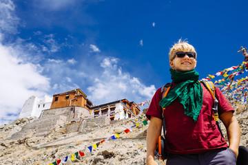 Young man traveler portrait near the Tibet Monastery