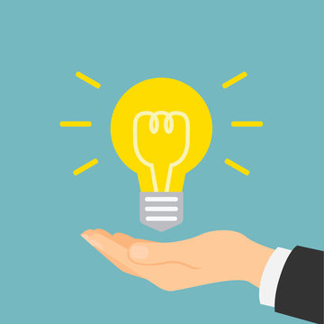 Hand with idea light bulb. Concept of innovation, solution, new plan and electricity.