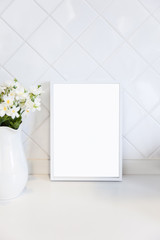 Mock up Blank Photo Frame on white tile wall with flower Home decoration