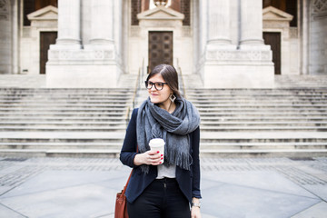 Woman standing in front of New York City Public Library