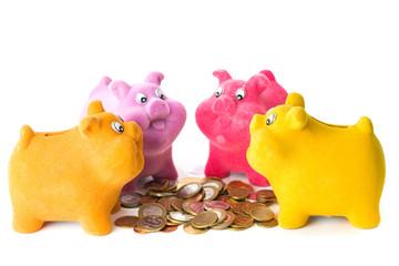 Four pig piggy bank near coins guests
