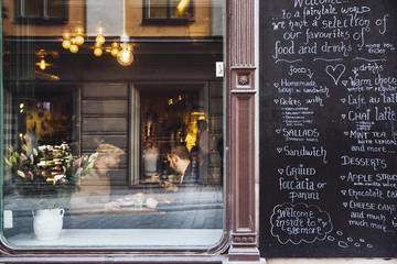 Sweden, Stockholm, Gamla Stan, Two men having coffee, seen through coffee shop window