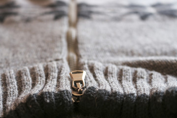 Warm men's sweater with ornament.