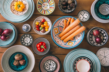 Directly above shot of ingredients in multi colored bowls arranged on table