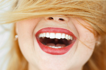 Happy laughing woman with red hair close-up. portrait of unrecognizable carroty girl with wide perfect smile. Fun, gladness, joy concept