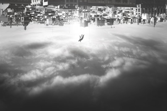 man falling from upside down city