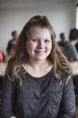 Portrait of schoolgirl (12-13) in classroom