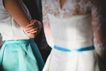 details of clothes guests and the bride