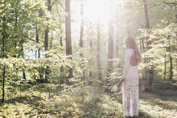 Beautiful bride in forest