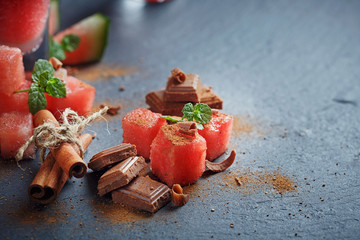 Delicious fresh slices of watermelon with cinnamon and chocolate