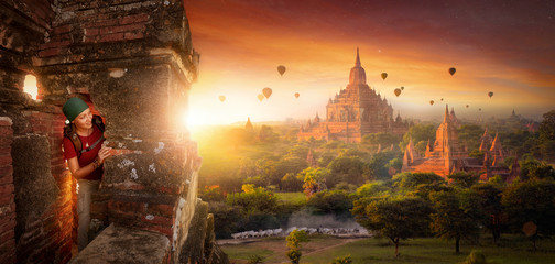 tourist explores the ancient temple on a background of sunrise