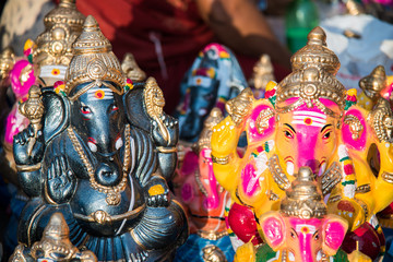 "Colorful god named ""Ganapati"" ready to sell in the market at south India. This is a very famous god for Hindu and this celebration done all over the India."