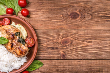 Spinach and cheese stuffed chicken breast  with rice. Background.
