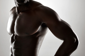 Young african man with muscular body Wall mural