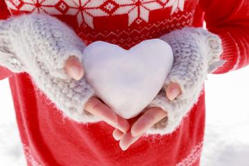 I love winter. Happy winter girl wearing knitted wear holding in