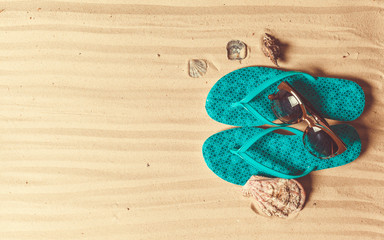 Holiday accessories on sand beach