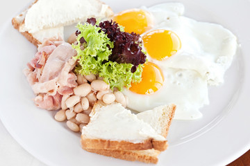 fried egg, vegetable salad and a grilled sandwich on a light bac