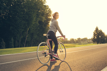 Active  woman riding a bicycle