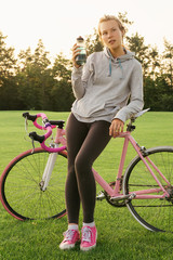 Woman quenches thirst after riding a bike