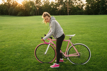 Active woman tired from riding a bicycle