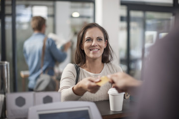 Customer paying for takeaway coffee by using credit card