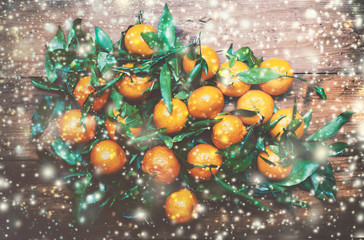 Christmas Card with festive decorations - fresh tangerines with