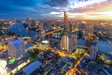 Bangkok river view at Dusk with modern business building along the Chao Phraya river (Thailand)