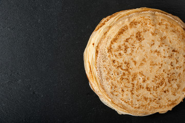 Stack of pancakes on black