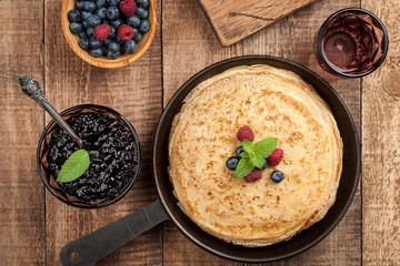 Crepes with fresh berries and jam