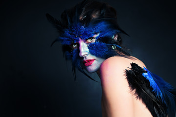 Halloween Makeup. Fantasy Bird Woman with Artistic Make-up