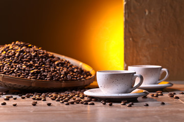 Cups of black coffee and  beans
