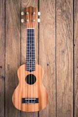 ukulele on old wodden background
