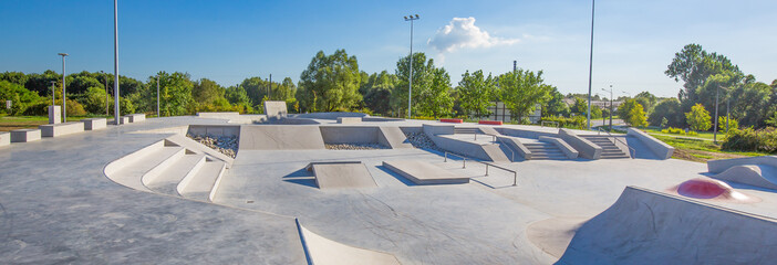 Skate Park in the daytime. Urban design concrete skatepark.
