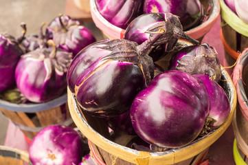 Large round purple eggplants at the market