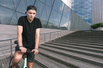 Young Man Riding a Fixie Bicycle
