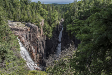 steep waterfall cascading into deep gorge