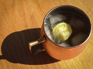 cold drink with lime in copper cup