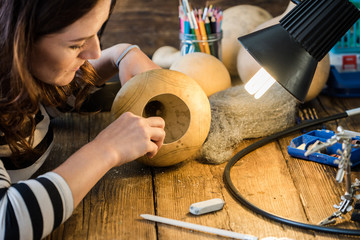 young woman creative craft in gourd
