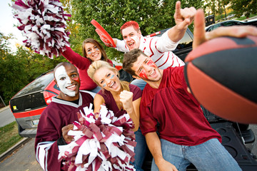 Tailgating: Group Of College Students Excited For Football Game
