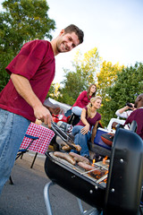 Tailgating: Man Working The Grill At Tailgate Party