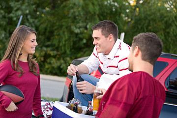 Tailgating: Friends Having Drinks And Talking About Game