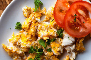 Scrambled eggs, on awooden table with text space